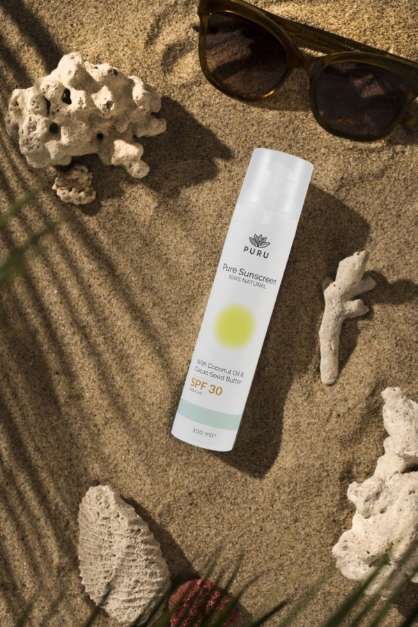 Pure 100% Natural Sunscreen SPF 30 on a beach