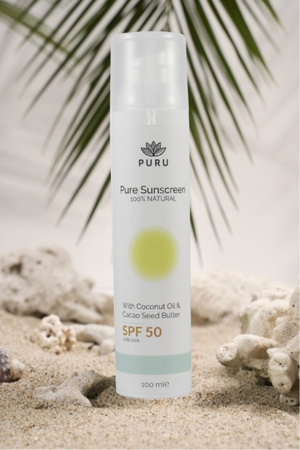Pure 100% Natural Sunscreen SPF 50 on a beach