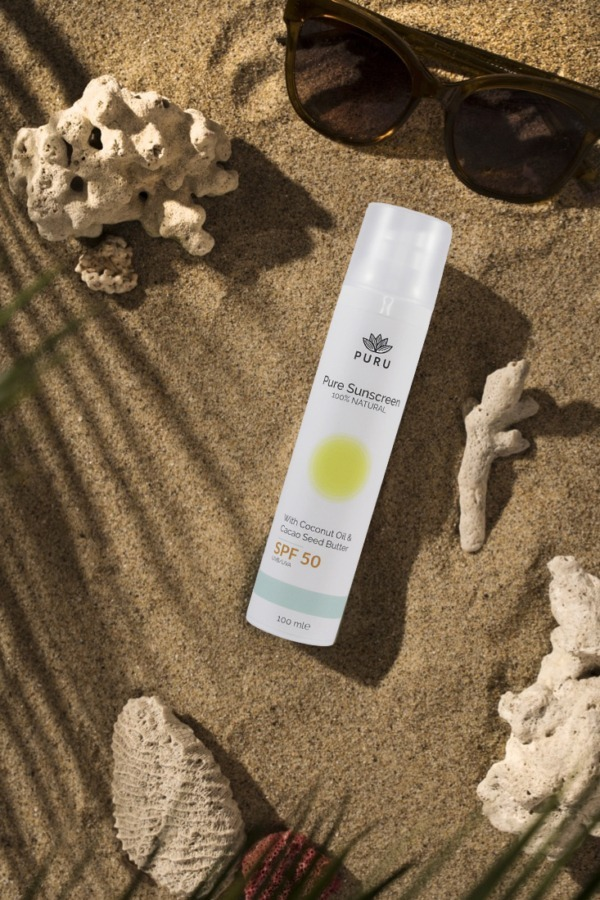 Pure 100% Natural Sunscreen SPF 50 on sand